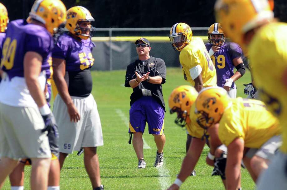 UAlbany football defensive coordinator Drew Christ, center, during practice on Thursday Sept. 5, 2013 in Albany, N.Y. (Michael P. Farrell/Times Union) Photo: Michael P. Farrell / 00023771A