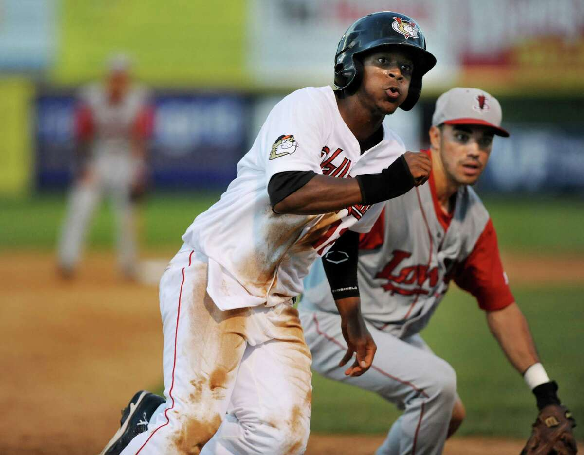 ValleyCats Ronnie Mitchell, left, looks to run home after an over throw to Lowell Spinners Carlos Asuaje, right, at third during their game on Friday, July 5, 2013, at Bruno Stadium in Troy, N.Y. (Cindy Schultz / Times Union)