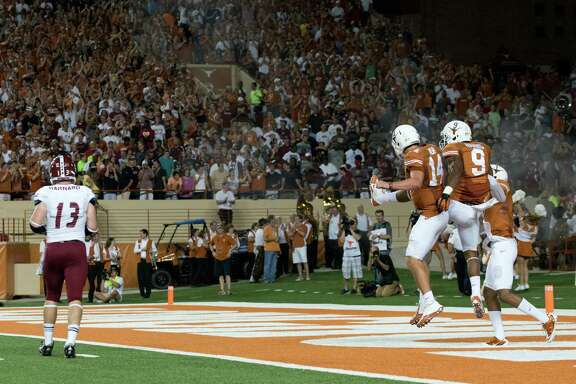 Quarterback David Ash (14) and the Longhorns have developed an uncanny ability to produce wins in bunches on the road, a trend they hope to keep up when they take on BYU this weekend.