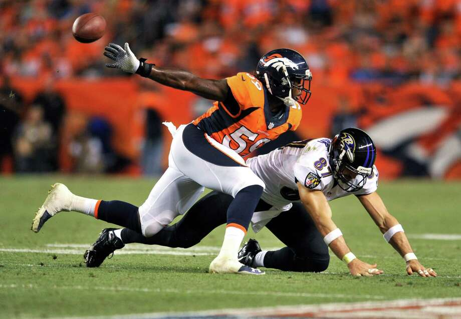Denver Broncos linebacker Danny Trevathan (59) breaks up a pass intended for Baltimore Ravens tight end Dallas Clark (87) during the first half of an NFL football game, Thursday, Sept. 5, 2013, in Denver. (AP Photo/Jack Dempsey) ORG XMIT: COMY145 Photo: Jack Dempsey / FR42408 AP