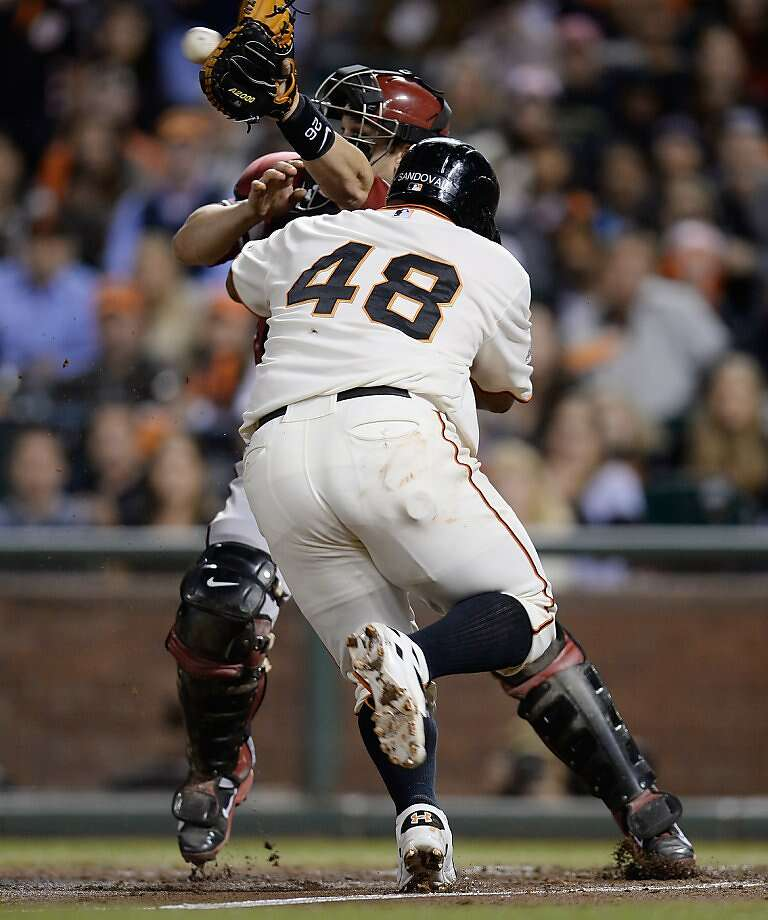 SAN FRANCISCO, CA - SEPTEMBER 05:  Pablo Sandoval #48 of the San Francisco Gaints on his way to score collides with catcher Miguel Montero #26 of the Arizona Diamondbacks in the fourth inning at AT&T Park on September 5, 2013 in San Francisco, California. Sandoval scored on a sacrifice fly from Hector Sanchez #29.  (Photo by Thearon W. Henderson/Getty Images) Photo: Thearon W. Henderson, Getty Images