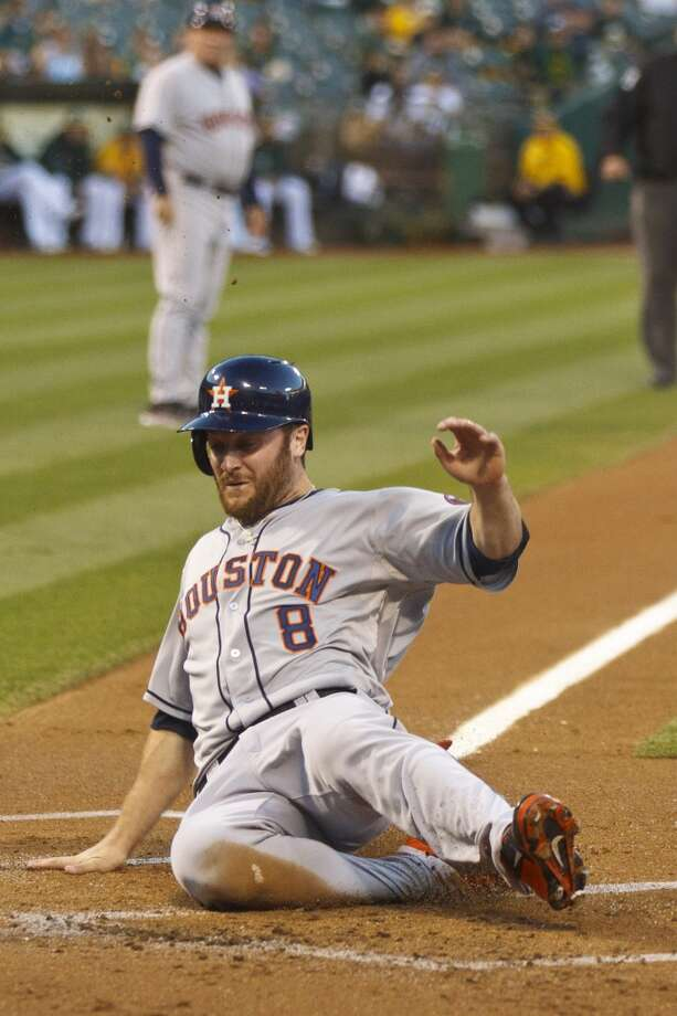 Trevor Crowe #8 of the Astros slides into home plate to score a run. Photo: Jason O. Watson, Getty Images