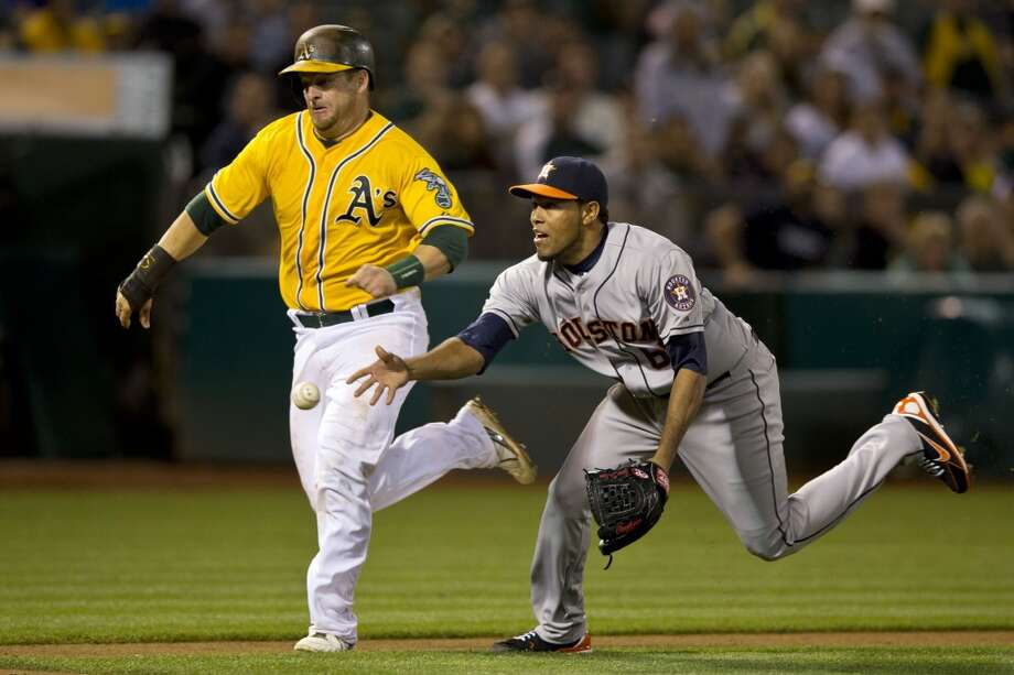 Stephen Vogt #21 of the Athletics runs past Jorge De Leon #67 of the Astros. Photo: Jason O. Watson, Getty Images