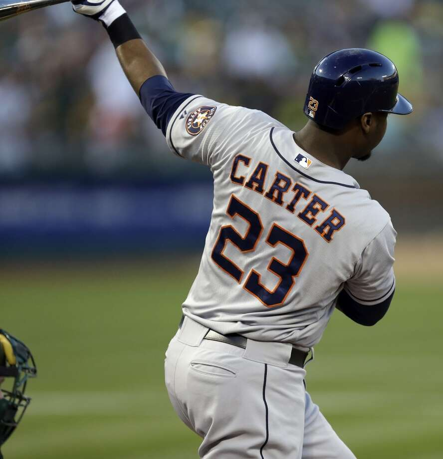 Chris Carter swings for an RBI-single. Photo: Ben Margot, Associated Press