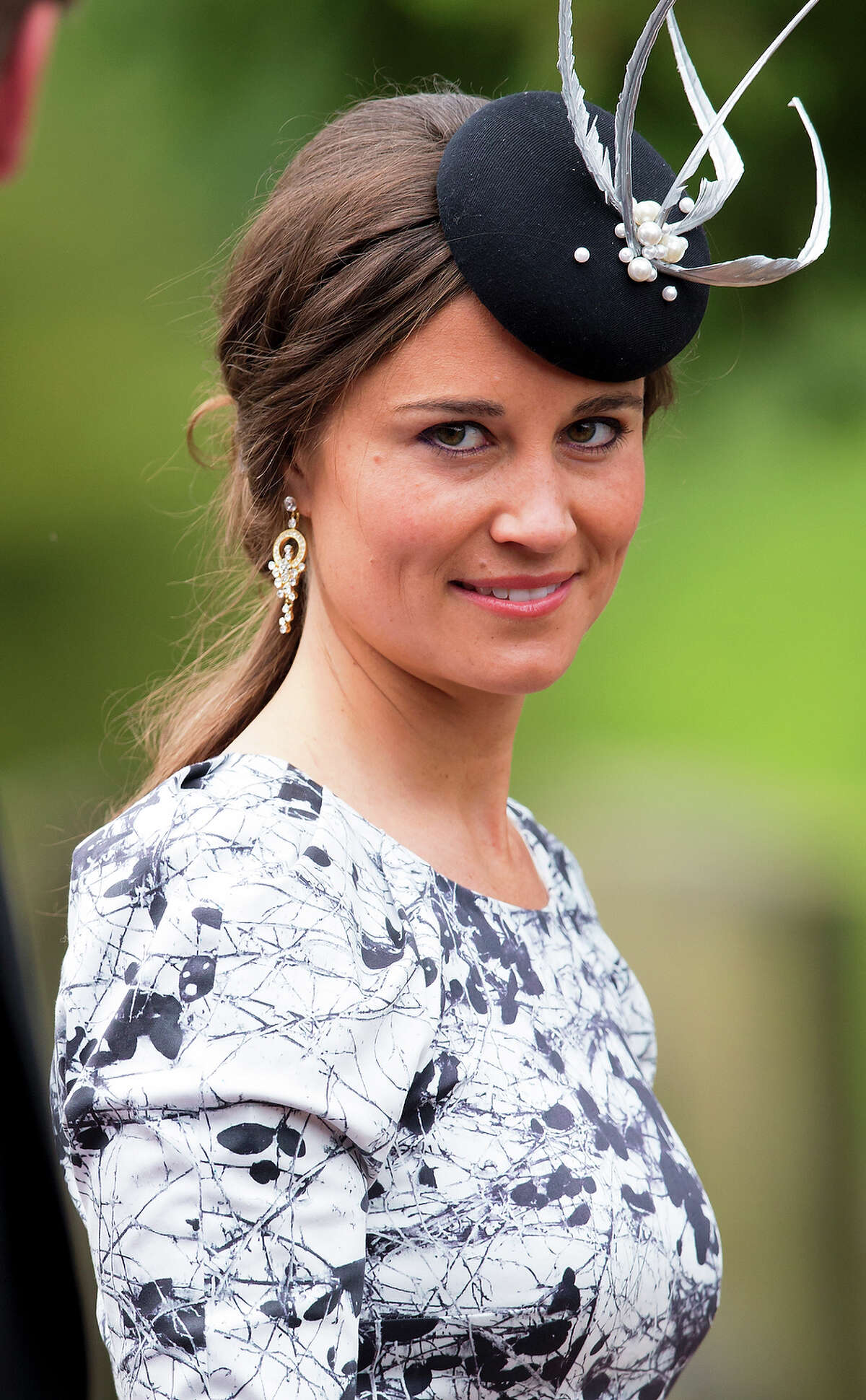 Pippa masters the all-important fascinator hat, which seems to be a must for socialites in England.