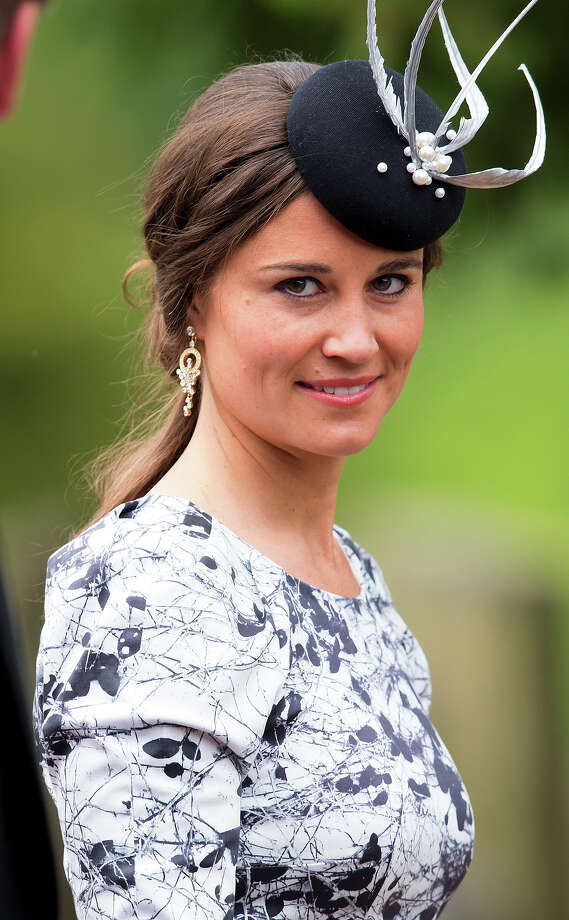 Pippa masters the all-important fascinator hat, which seems to be a must for socialites in England.  Photo: Max Mumby/Indigo, Getty Images / 2013 Max Mumby/Indigo