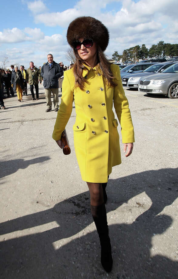 It's hard not to have a great day in a bright yellow coat.  Photo: Danny Martindale, Getty Images / 2013 Getty Images