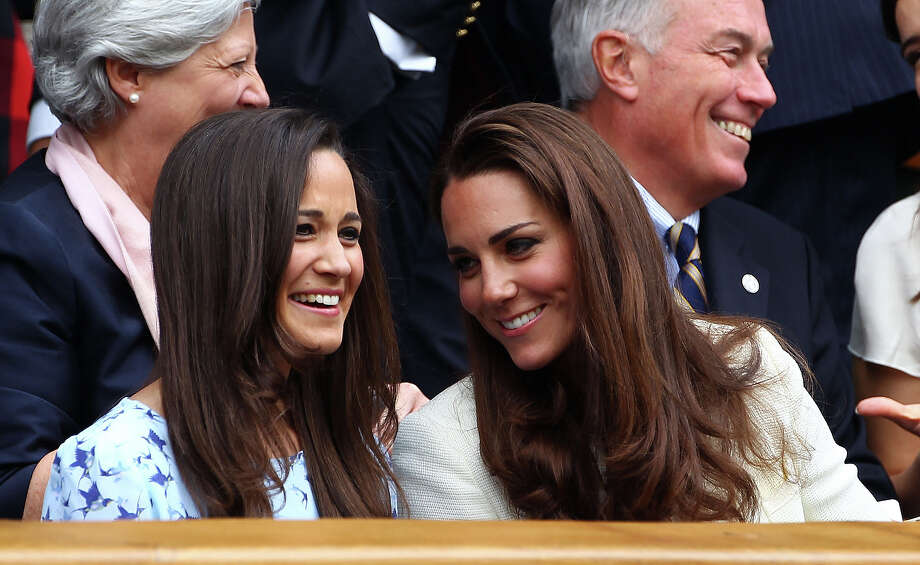 Sisters share a laugh at Wimbledon. Photo: Clive Brunskill, Getty Images / 2012 Getty Images