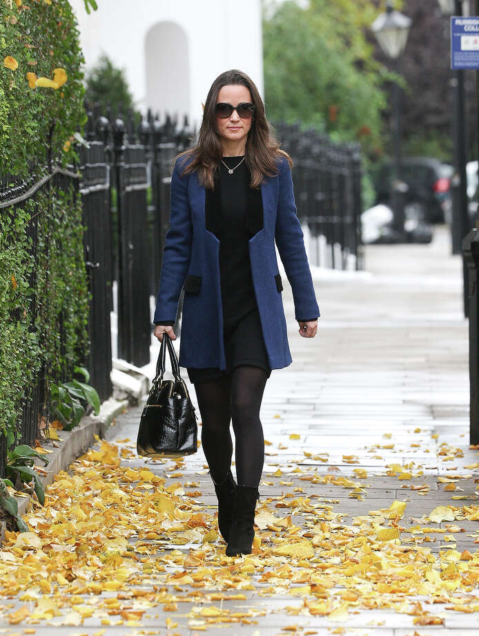 Pippa finishes every outfit with the perfect bag. Photo: Alex Moss, FilmMagic / 2011 Alex Moss