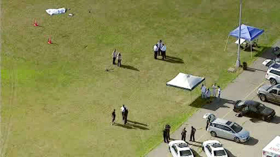 In this image taken from video and provided by WABC-TV in New York, investigators stand near a remote controlled toy helicopter, center, that apparently struck and killed a 19-year-old man, top left, Thursday, Sept. 5, 2013, at Calvert Vaux Park in the Brooklyn borough of New York. It wasn't immediately clear how the accident occurred and police didn't immediately say if the man was operating the remote control helicopter he was struck by.  MANDATORY CREDIT, Photo: WABC-TV