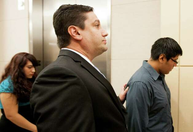 Luis Alonzo Alfaro, 17, attorney Milan Marinkovich leaves the 262nd District Court on Friday, Sept. 6, 2013, in Houston.  Alfaro is charged with murder accused of fatally stabbing 17-year-old Joshua Broussard at Spring High School. Photo: J. Patric Schneider, For The Chronicle / © 2013 Houston Chronicle
