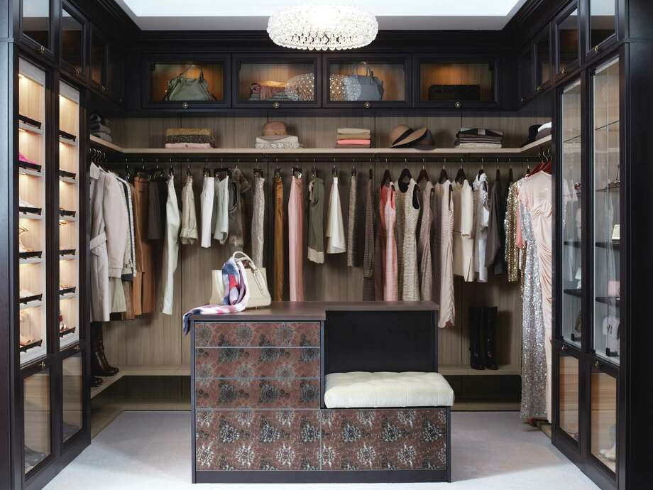 Glass doors over boutique-style leather and glass shelving lend to a closet's chic look, a trend for 2013 and forward. The boutique look isn't just about having a larger closet but also about its appointments and fashionable look. Photo: Photo Courtesy California Closet Co.