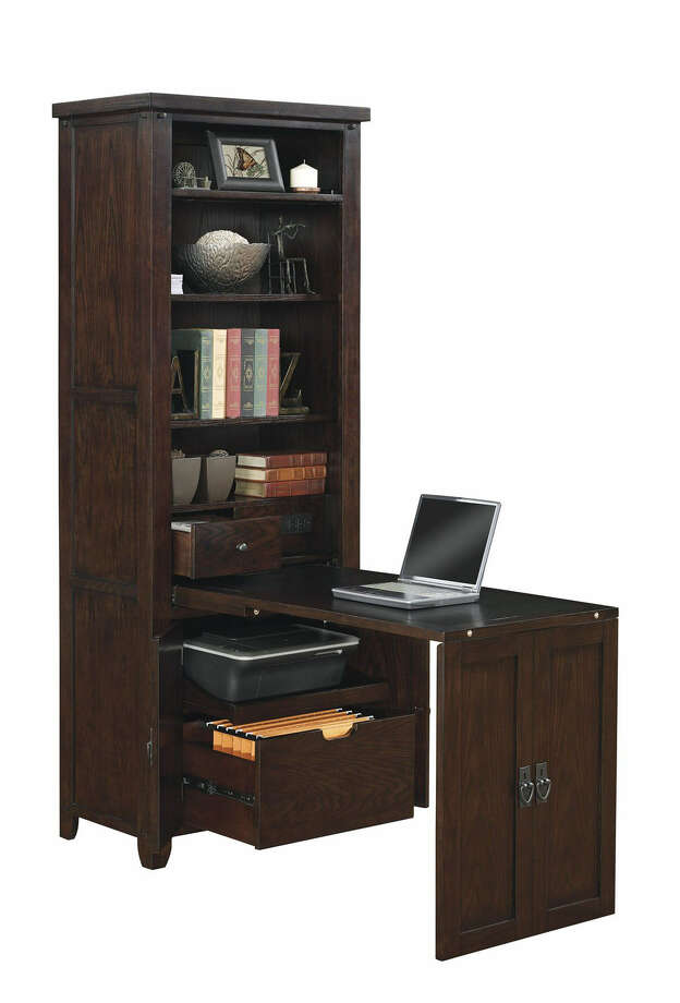 This Murphy desk features a cabinet door that pulls down to create a desk surface. Photo: Associated Press