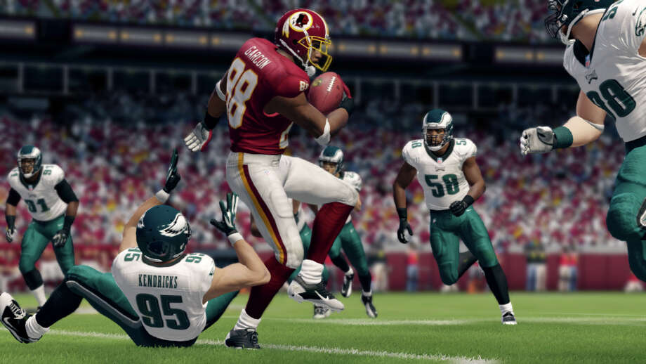 "This video game image released by EA Sports shows an animated version of Redskins' Pierre Garcon, center, during game action in ""Madden NFL 25."" (AP Photo/EA Sports) ORG XMIT: NYET137 / EA Sports"