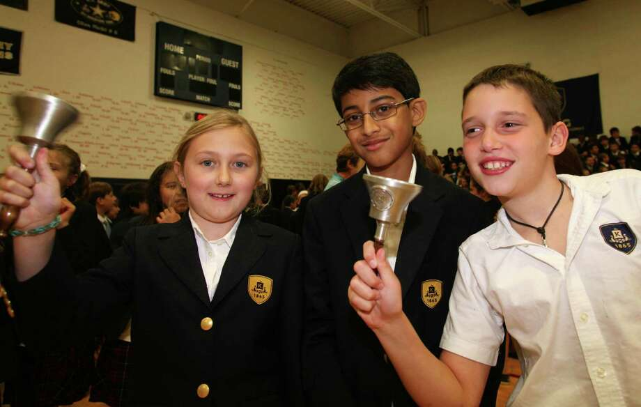 King fourth graders Gillian Frey, Arin Shrivastava and Owen Donovan take part in a traditional bell-ringing ceremony to mark the beginning of the school year Friday.  September 6, 2013. Photo: David Ames / Greenwich Time