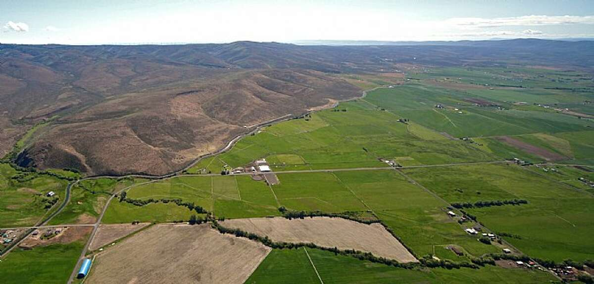Want to work in Seattle during the week and then fly away to a ranch for the weekend? Check out Venture Farms, 1850 Venture Road, in Ellensburg, scheduled to go up for auction on Sept. 12. The 579-acre range includes an office, a
