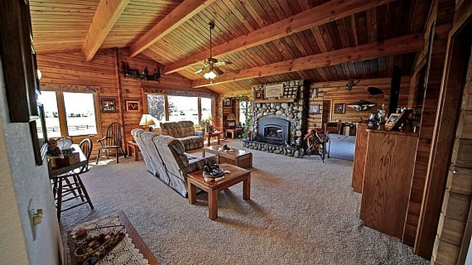 Main house living room of Venture Farms, 1850 Venture Road, in Ellensburg. It is scheduled to go up for auction on Sept. 12. Photo: J.P. King Auction Co.