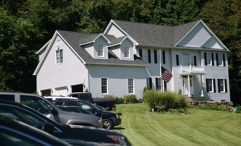 The flag is at half-staff at the home of the father of Todd Lobraico, a US soldier who was killed in Afghanistan, in Sherman, Conn. on Friday, Sept. 6, 2013. Photo: Tyler Sizemore / The News-Times