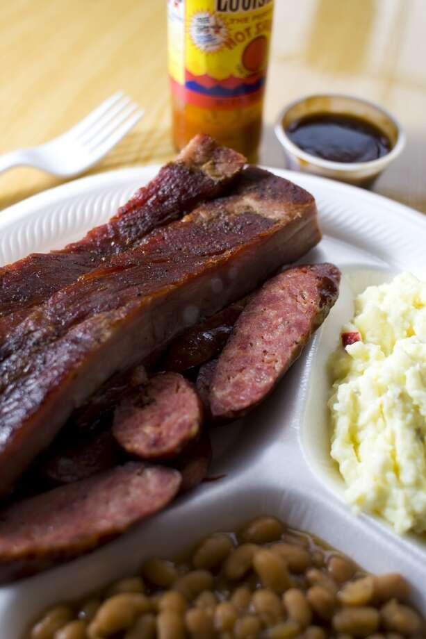 Virgie's BBQ's pork ribs and sausage. Photo: Nick De La Torre, Houston Chronicle