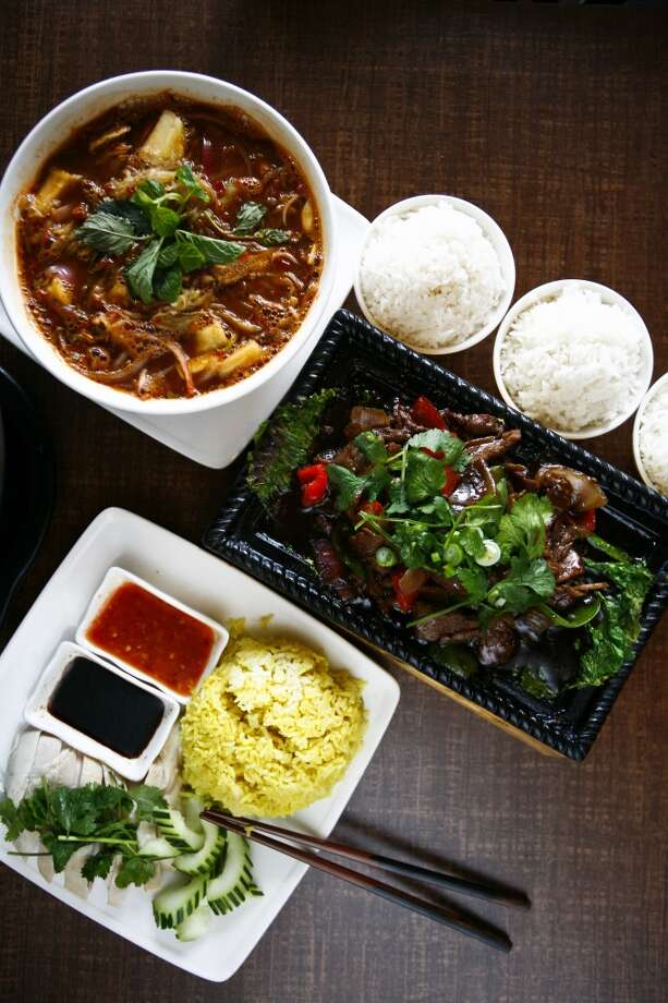 The Penang Assam Laksa noodle soup (top to bottom), the Sizzling Beef With Black Pepper platter and the Hainanese Chicken with Rice dish at Banana Leaf Malaysian Cuisine, 9889 Bellaire. Photo: Michael Paulsen, Houston Chronicle