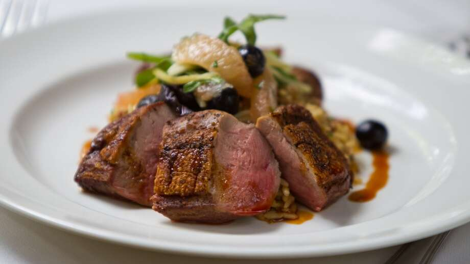 Brennan's duck dish with sausage and dirty rice. Photo: Nick De La Torre, Houston Chronicle