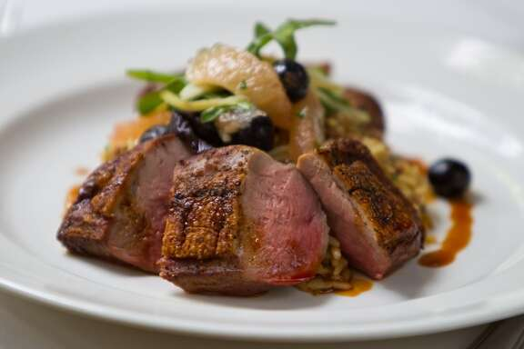 Brennan's restaurant's duck dish with sausage and dirty rice
