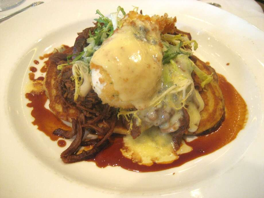 Brennan's of Houston's Sunday brunch includes sweet potato pancakes topped with lamb debris, poached egg and mint julep hollandaise.