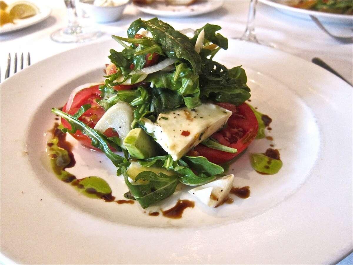 Heirloom tomato salad with mozzarella, arugula and basil oil at Brennan's Houston.