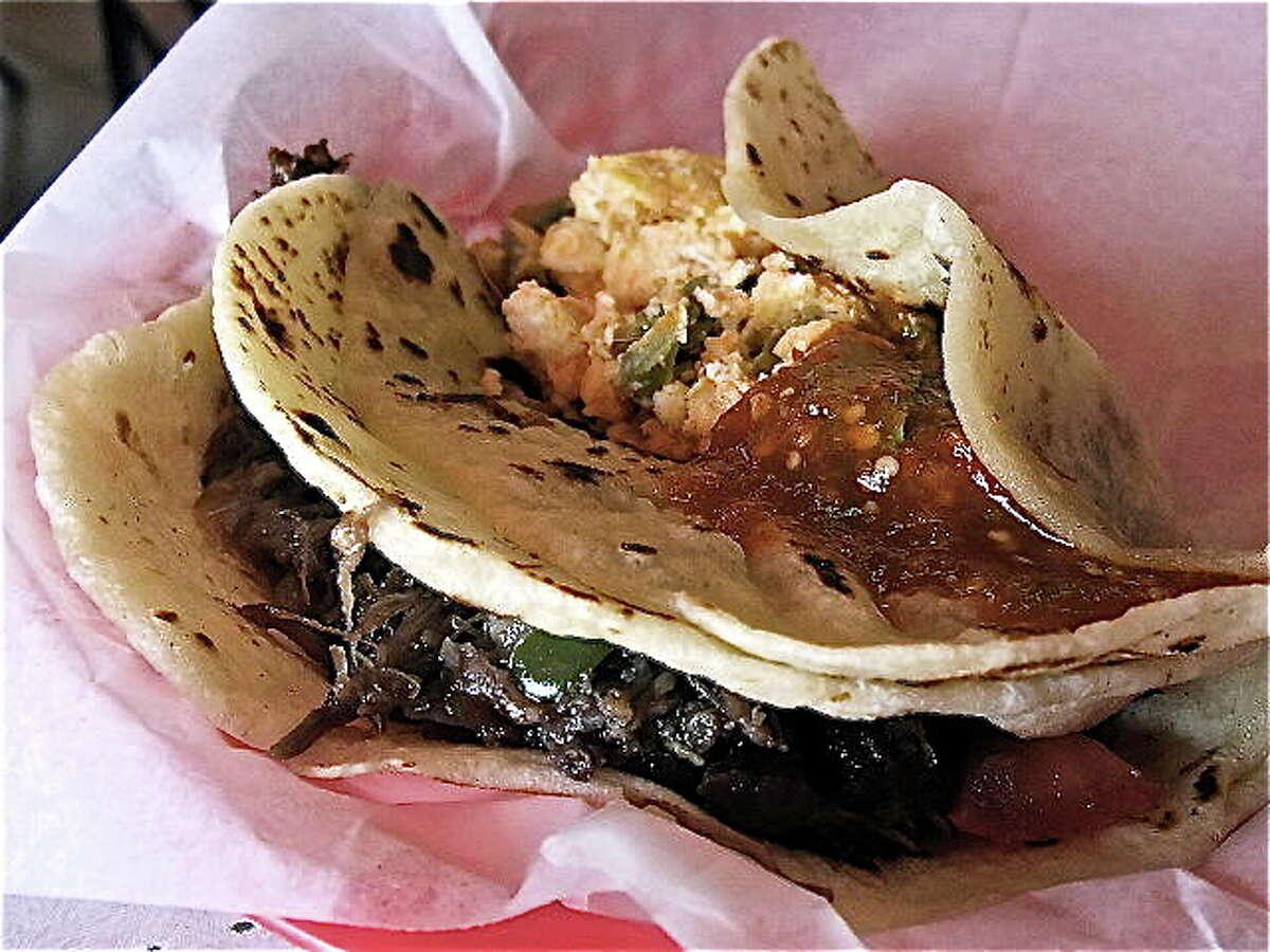 Eggs with nopalitos and barbacoa tacos at Taqueria Laredo