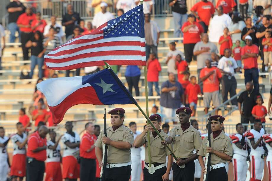 Color guard during Memorial's match up with the Central Jaguars Friday night at the Thomas Stadium. Photo taken Friday, August 30, 2013 Guiseppe Barranco/The Enterprise Photo: Guiseppe Barranco/The Enterprise