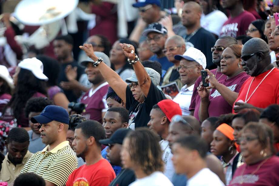Central fans cheer during the Jaguar's match up with Memorial Friday night at the Thomas Stadium. Photo taken Friday, August 30, 2013 Guiseppe Barranco/The Enterprise Photo: Guiseppe Barranco/The Enterprise