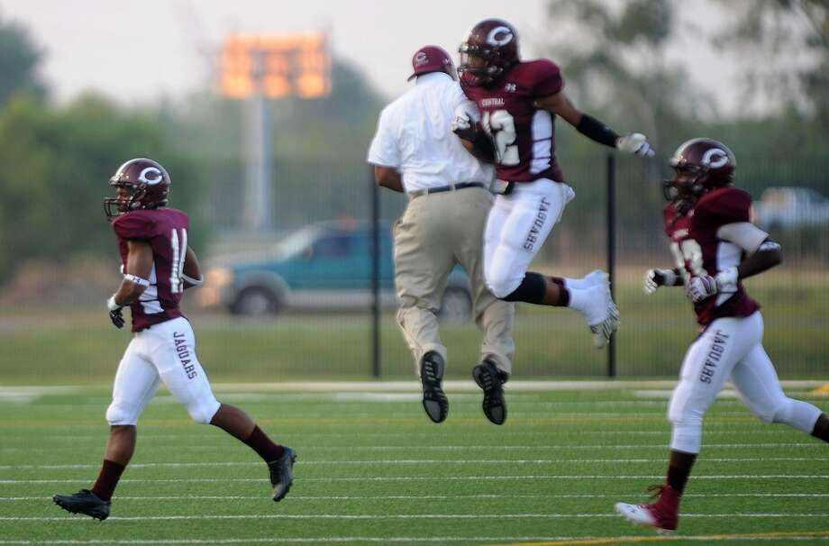 A Central coach jumps into Devwah Whaley after Derek Broussard makes an interception. Photo taken Friday, August 30, 2013 Guiseppe Barranco/The Enterprise Photo: Guiseppe Barranco/The Enterprise