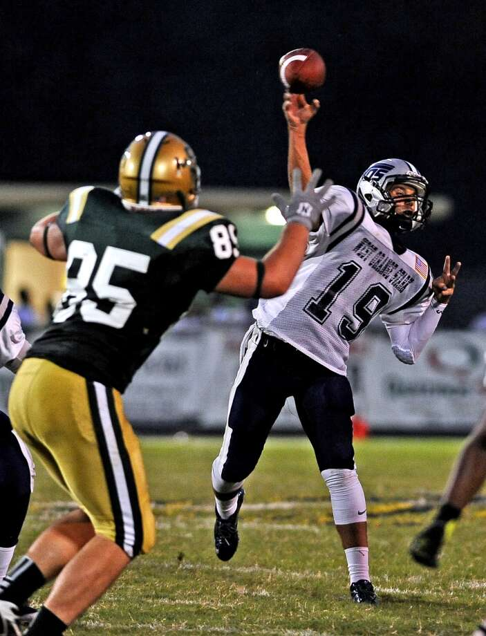 WO-S quarterback Chase Rutledge, #19, throws down the field as LC-M defensive lineman Matthew Chitty, #85, tries to block during the Little Cypress-Mauriceville High School football game against West Orange-Stark High School football game in Orange on Friday, August 30, 2013. Photo taken: Randy Edwards/The Enterprise Photo: Beaumont Enterprise