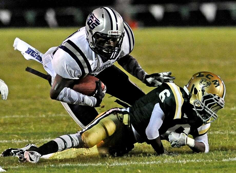 WO-S wide receiver Will Johnson, #83, is knocked to the ground by LC-M defensive back Josh Provost, #6, during the Little Cypress-Mauriceville High School football game against West Orange-Stark High School football game in Orange on Friday, August 30, 2013. Photo taken: Randy Edwards/The Enterprise Photo: Beaumont Enterprise