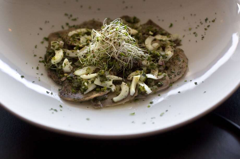 Beef tounge with South American vinaigrette at the Galleria neighborhood restaurant Tango and Malbec Photo: Johnny Hanson, Houston Chronicle