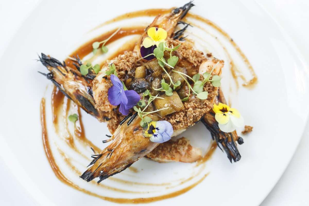 The Grilled Prawns with Smoked Eggplant, Roast Hazelnuts and Membrillo at Restaurant Cinq inside La Colombe d'Or Hotel.