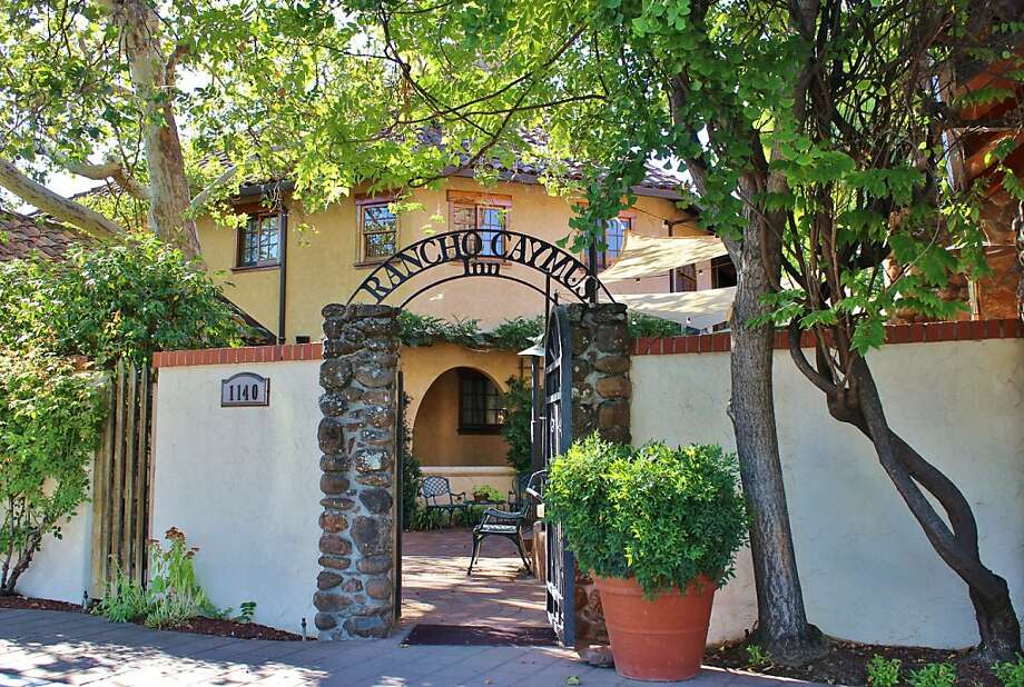 Rancho Caymus Inn1140 Rutherford Road: The curved archways, stucco walls and scrolling iron work of this inn, designed by Mary Lee Tildon, echo the namesake hacienda that once existed here. Near tasting rooms and wineries, it features cozy rooms with rustic wood accents, some with fireplaces and kitchenettes. (800) 845-1777. www.ranchocaymus.com. Photo: Stephanie Wright Hession, Special To The Chronicle