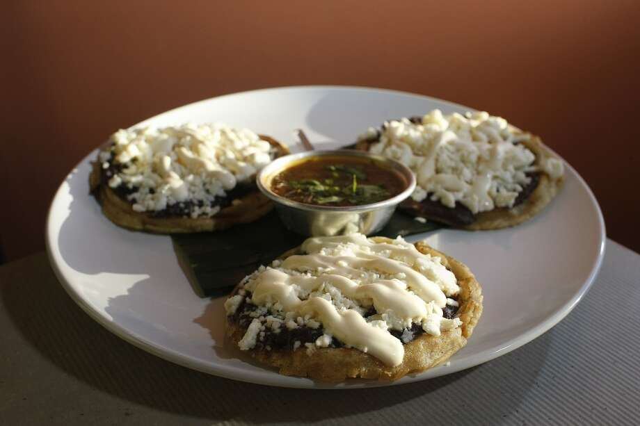Picaditas with refried beans, salsa and Mexican cream cheese at Cuchara Friday, Nov. 9, 2012, in Houston. ( Johnny Hanson / Houston Chronicle ) Photo: Houston Chronicle