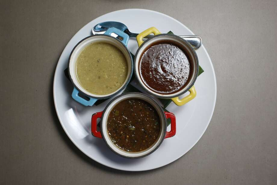 Trio of salsas, Aunt Martha with tomatillos and peanuts, left, five chiles with five peppers and pork rinds, right, and burnt pepper skin, center at Cuchara Friday, Nov. 9, 2012, in Houston. ( Johnny Hanson / Houston Chronicle ) Photo: Houston Chronicle