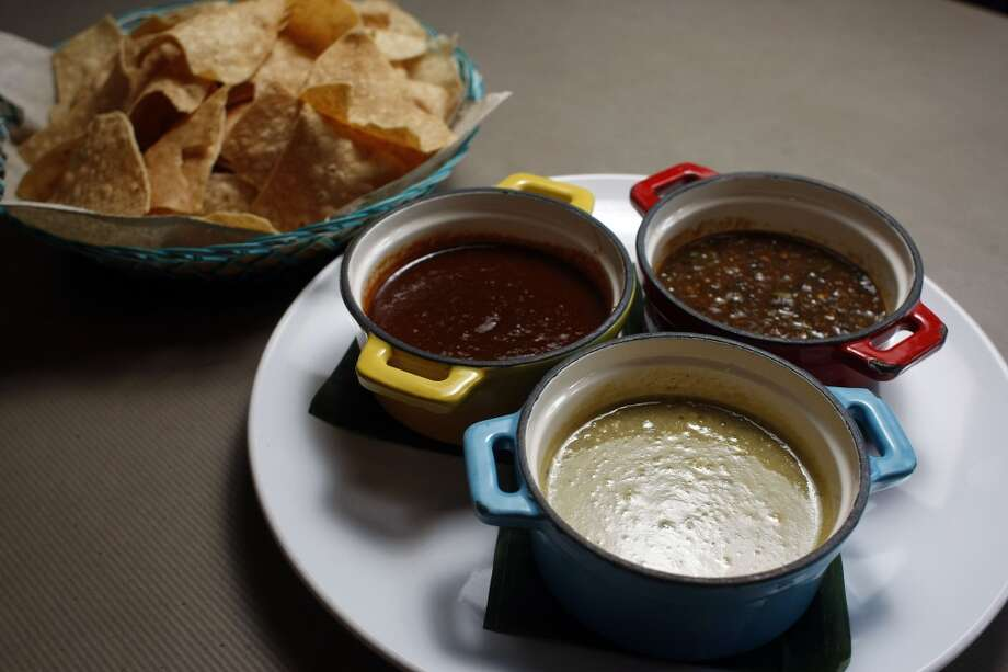 Trio of salsas, Aunt Martha with tomatillos and peanuts, center, five chiles with five peppers and pork rinds, left, and burnt pepper skin, right at Cuchara Friday, Nov. 9, 2012, in Houston. ( Johnny Hanson / Houston Chronicle ) Photo: Houston Chronicle