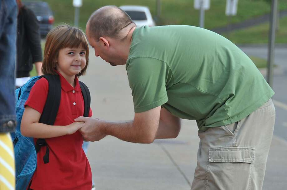 First-day fears: Steve Verzak tries to reassure his daughter, Alexandra, a first-grader, on the first day of 