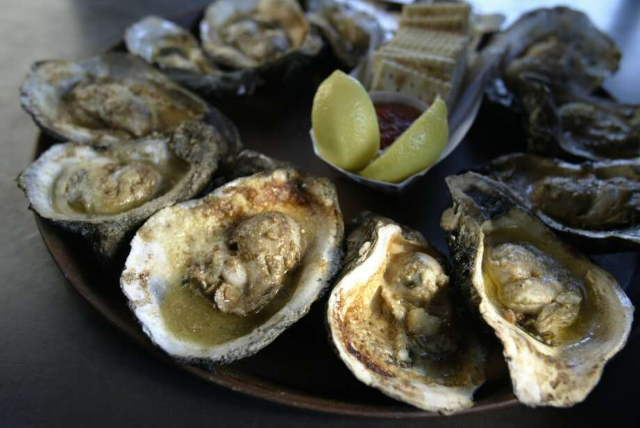 Gilhooley's oyster bar shows off their oysters roasted with garlic butter and parmesan. Photo: Kevin Fujii, Houston Chronicle
