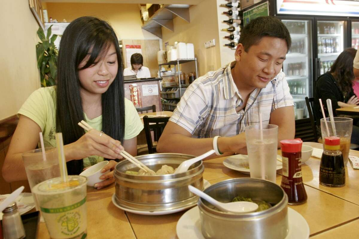 Mimi Tran and Steve Van enjoy the Steamed Pork Bun at Fu Fu Cafe.