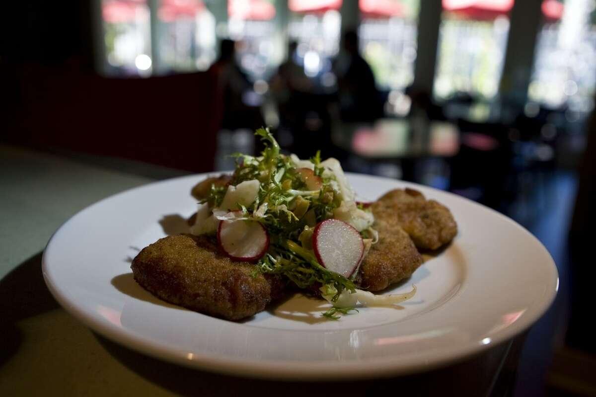 Cotoletta di Maile alla Milanese pork lion chop breaded and sauteed at Giacomo's