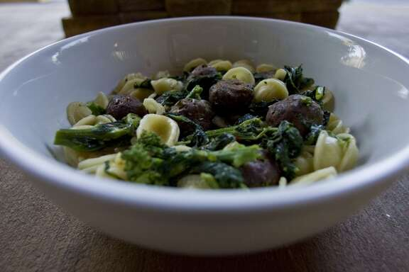 "Orecchiette Giorgione ""little ear"" pasta with broccoli rabe, garlic & oil, spicy lamb meatballs at Giacomo's"
