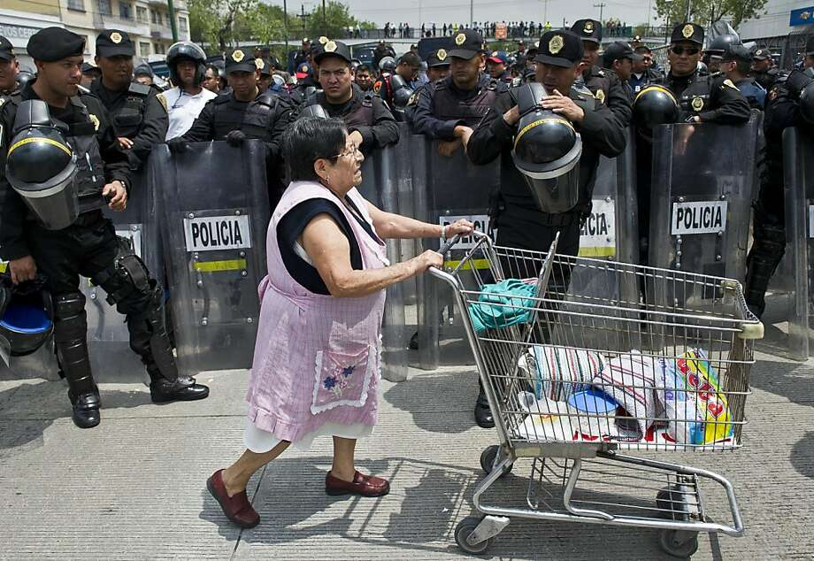 Tamales! Enchiladas! You can't repress on an empty stomach, amigos! A woman hawks 