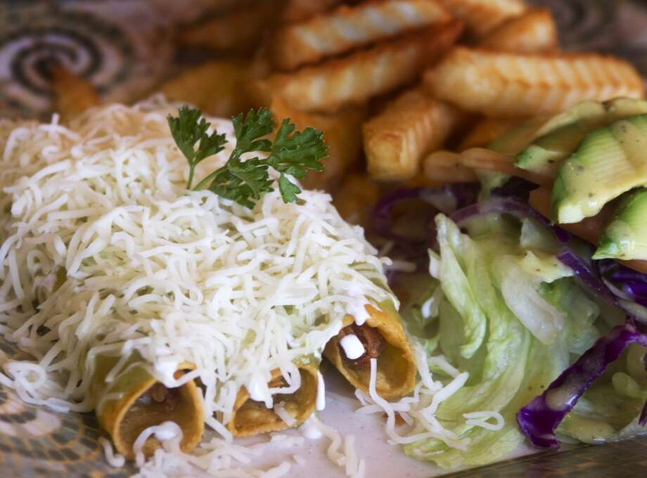 Chicken taquitos are served at Pollo Bravo. Photo: J. Patric Schneider, For The Houston Chronicle