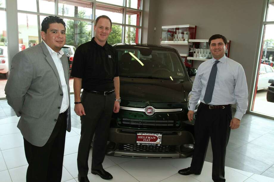 Jason Stoicevich, center, head of FIAT Brand North America was at Helfman FIAT recently to brief reporters on how the roomier new 2014 500L has helped boost sales. Flanking him at right were Helfman's general sales manager, Jason B. Feldman and Leo Revilla, Helfman FIAT studio director. Photo: Jeff Yip Photo / (c) Jeff Yip, 2013 All rights reserved