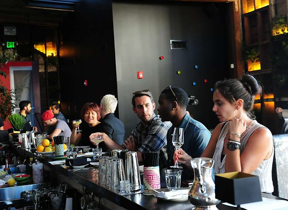 Lauren Cayford (right) is among the bar-goers at the new La Urbana on Divisidero and Grove. Photo: Susana Bates, Special To The Chronicle
