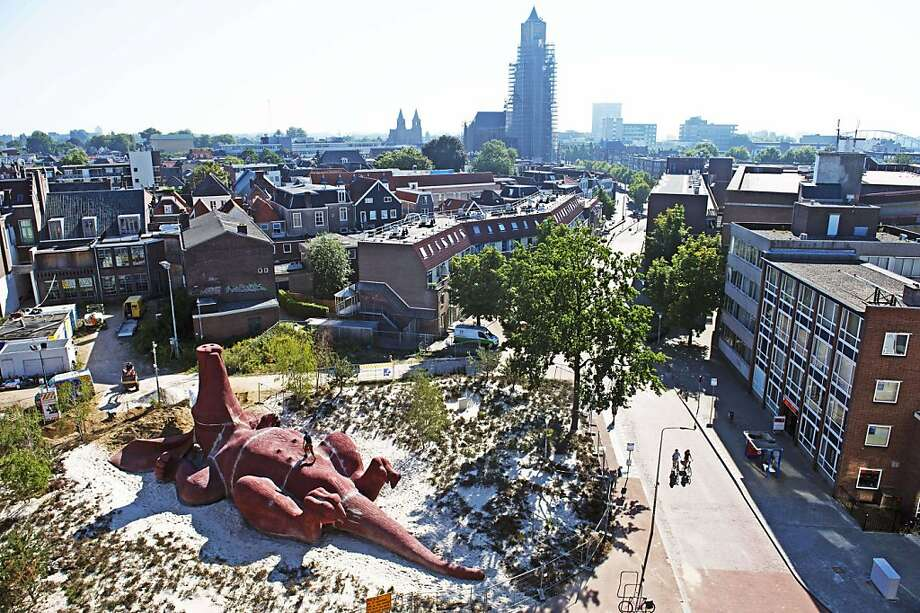 Like a dog hoping for a belly rub,a giant aardvark lies on its back in this nearly completed statue by Dutch artist Florentijn Hofman in Arnhem, Netherlands. The statue is a gift to the city by the Royal Burgers' Zoo, which is celebrating its 100th anniversary. Photo: Robin Utrecht, AFP/Getty Images